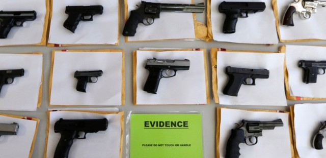 Chicago police display some of the nearly 3,400 illegal firearms