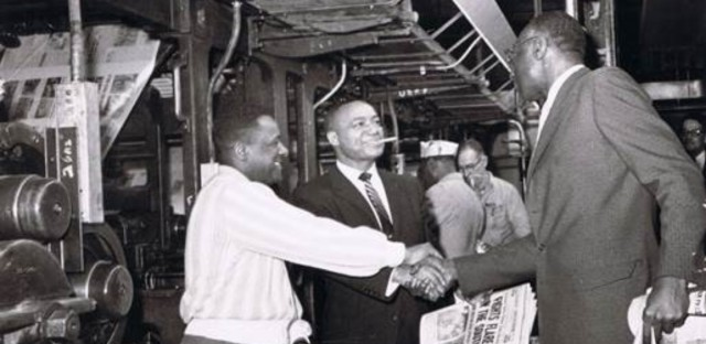 Chicago Defender publisher John H. Sengstacke celebrates a good run at the printing presses in 1960.