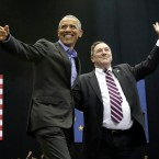 Former President Barack Obama, left, points as Democratic congressional candidate U.S. Sen. Joe Donnelly waves to the crowd during a campaign rally at Genesis Convention Center in Gary, Ind. on Sunday, Nov. 4, 2018.