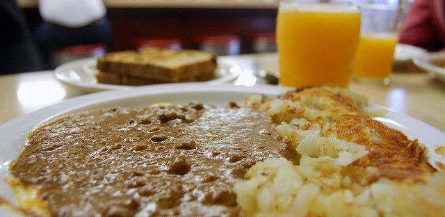 Chili on eggs, hash brown potatoes, double toast, and fresh-squeezed orange juice at Ramova Grill, 1929-2012
