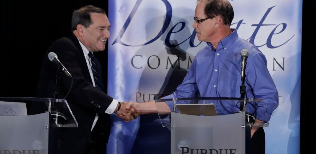 Democratic Sen. Joe Donnelly, left, shakes hands with Republican former state Rep. Mike Braun following a U.S. Senate Debate on Oct. 8 in Westville, Ind. Libertarian Lucy Brenton also participated in the debate.