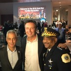 """Former Officer Brian Warner (center) stands next to Chicago Mayor Rahm Emanuel and Police Superintendent Eddie Johnson. In January, the police pension board voted 6-1 to cut Warner's benefit from a duty-related disability benefit to an """"ordinary disability benefit,"""" which Warner says is going to cost him about $2,500 a month."""