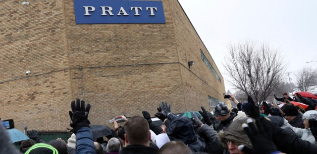 Family, friends and community members attend a vigil Sunday, Feb. 17, 2019, in Aurora, Ill., after six people, including a gunman, died in a shooting at a manufacturing warehouse in Aurora the previous Friday.
