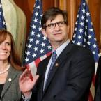 U.S. Rep. Bob Dold (right) and Democrat Brad Schneider (left) at their respective swearing-in ceremonies.