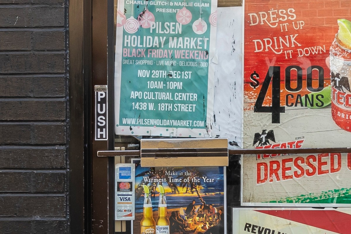 The door of Harbee is plasterd with posters for drinks and community events.