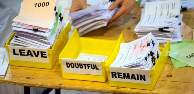Votes are sorted into remain, leave and doubtful trays as ballots were counted during the EU Referendum count for Westminster and the City of London at the Lindley Hall in London.