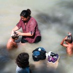Migrants bathe in the Rio Grande in Matamoros, Mexico. On the other side of the river is the United States, where many who have settled in Matamoros seek to gain asylum.