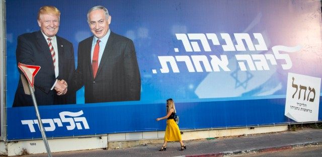 "A woman walks by an election campaign billboard for the Likud party that shows Israeli Prime Minister Benjamin Netanyahu, right, and US President Donald Trump, in Tel Aviv, Israel, Sunday, Sept 15, 2019. Hebrew on billboard reads ""Netanyahu, in another league."""