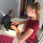 Jodi Meyer's daughter Megan, a rising ninth-grader in the Ankeny Community School District in Iowa, works on her school-provided laptop while on summer break.