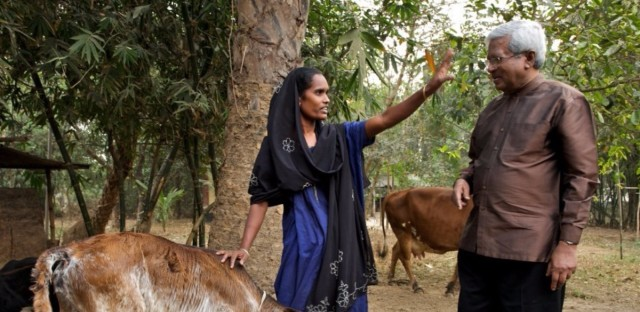 """Abed meets with a Bangladeshi villager who was given a cow as part of BRAC's """"graduation program."""""""