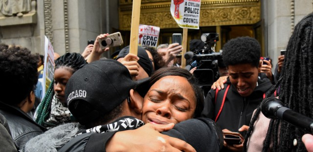 People react outside of City Hall after a jury convicted white Chicago police Officer Jason Van Dyke of second-degree murder