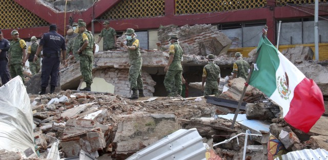 Soldiers remove debris from a partly collapsed municipal building, which was felled by a massive earthquake, in Juchitan, Oaxaca state, Mexico, on Friday.