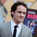 """In this June 11, 2015, file photo, Anton Yelchin arrives at a special screening of """"Burying the Ex"""" held at Grauman's Egyptian Theatre in Los Angeles. Yelchin, a charismatic and rising actor best known for playing Chekov in the new """"Star Trek"""" films, has died at the age of 27. He was killed in a fatal traffic collision early Sunday morning, June 19, 2016, his publicist confirmed."""