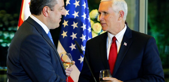 Georgian Prime Minister Giorgi Kvirikashvili, left, shakes hands with Pence during an official dinner in Tbilisi on Monday.