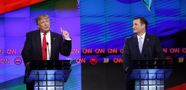Republican presidential candidate, businessman Donald Trump speaks, as Republican presidential candidate, Sen. Ted Cruz, R-Texas, listens, during the Republican presidential debate sponsored by CNN, Salem Media Group and the Washington Times at the University of Miami, Thursday, March 10, 2016, in Coral Gables, Fla.