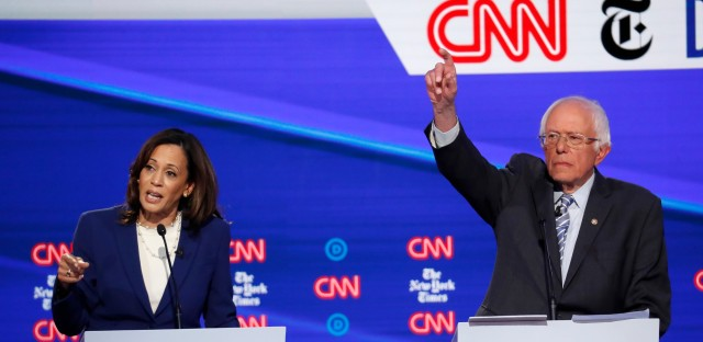 Democratic presidential candidate Sen. Kamala Harris, D-Calif., and Sen. Bernie Sanders, I-Vt., right, participate in a Democratic presidential primary debate hosted by CNN/New York Times at Otterbein University, Tuesday, Oct. 15, 2019, in Westerville, Ohio.