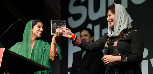 """Sonita Alidazeh, left, subject of the documentary film """"Sonita,"""" and the film's director Rokhsareh Ghaem Maghami accept the World Cinema Documentary Grand Jury Prize for the German/Iranian/Swiss film during the 2016 Sundance Film Festival Awards."""