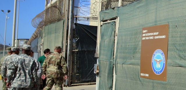 In this Feb. 2, 2016 photo, military personnel enter Camp 6 at the U.S. detention center at Guantanamo Bay, Cuba. After 14 years, the detention center appears to be winding down despite opposition in Congress to President Barack Obama's intent to close the facility and confine the remaining prisoners someplace else.
