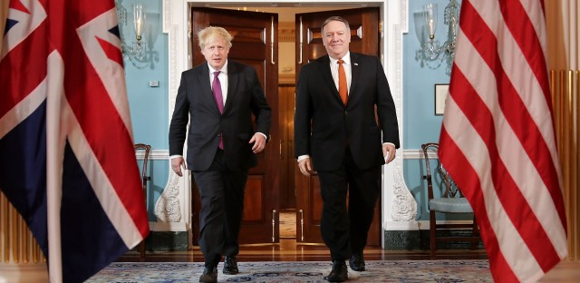 """British Foreign Secretary Boris Johnson (left) meets with Secretary of State Mike Pompeo at the State Department Monday. Johnson argued for the Trump administration to continue to be a party to the 2015 Iran nuclear deal. """"The wisest course would be to improve the handcuffs rather than break them,"""" Johnson wrote in the New York Times."""