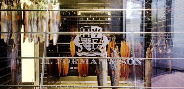 Fillets of smoked salmon hang in the smokehouse of H. Forman & Son, founded in 1905. Its owner, Lance Forman, says he'll vote to leave the EU despite the risks it poses to his bottom line.