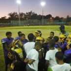 Mo Better Jaguars' coaches and players huddle at the end of practice at Betsy Head Park in Brownsville, Brooklyn in September 2014. Courtesy of Albert Samaha