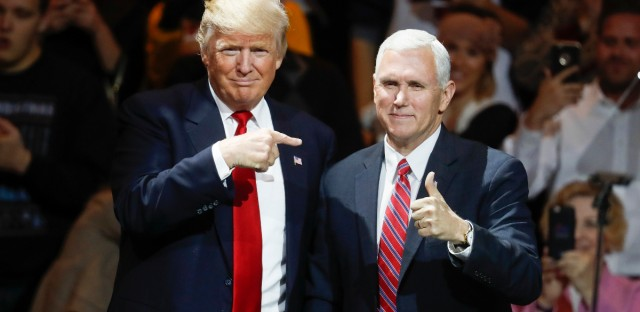 President-elect Donald Trump, left, and Vice President-elect Mike Pence acknowledge the crowd during the first stop of his post-election tour, Thursday, Dec. 1, 2016, in Cincinnati. (AP Photo/John Minchillo)