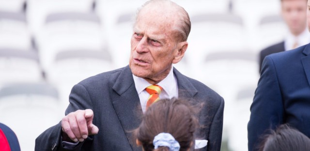 Prince Philip, seen here meeting pupils from St. Edward's Catholic Primary School Wednesday, will stop accepting invitations to public events beginning in September.