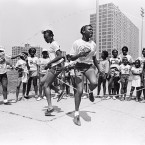 "Two girls double dutching (original Sun-Times caption simply says: ""Olympic-like events""), Cabrini-Green, SUN-TIMES NEGATIVE COLLECTION, 1984"