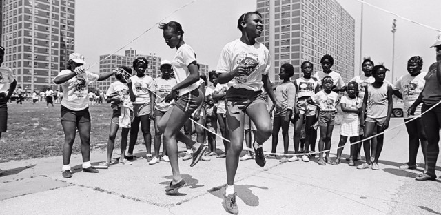 """Two girls double dutching (original Sun-Times caption simply says: """"Olympic-like events""""), Cabrini-Green, SUN-TIMES NEGATIVE COLLECTION, 1984"""