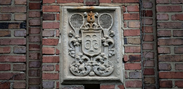 The crest for the Chicago Town and Tennis Club remains high atop the chimney of Unity Chicago's church.