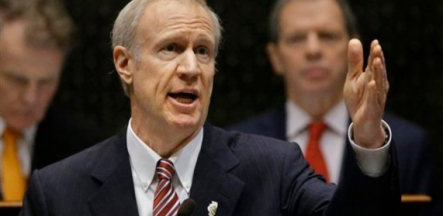 File: Illinois Gov. Bruce Rauner delivers his State of the State address to a joint session of the General Assembly, Wednesday, Feb. 4, 2015, at the Capitol in Springfield.