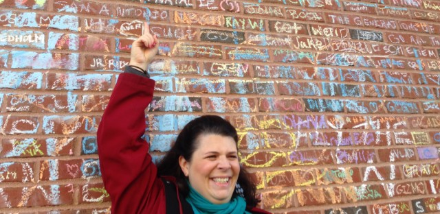 Julie Nichols points to the name of her father-in-law, written on the wall at Wrigley Field by a fellow fan who had chalk, and a ladder.