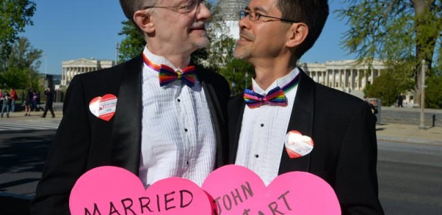 A gay couple, John and Stuart from California, married from 28 years, pose outside the US Supreme Court waiting for its decision on April 28, 2015 in Washington, DC.