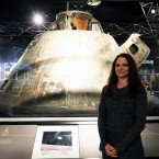 Voula Saridakis, curator at the Museum of Science and Industry, stands in front of the Apollo 8 Command Module.