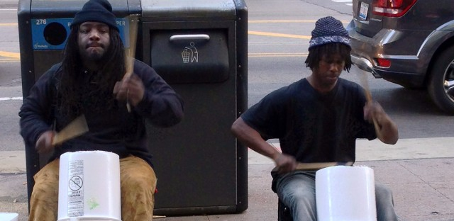 Two bucket boys perform one afternoon near State and Washington streets.