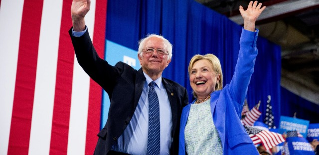Democratic presidential candidate Hillary Clinton and Sen. Bernie Sanders, I-Vt. wave to supporters during a rally in Portsmouth, N.H., Tuesday, July 12, 2016, where Sanders endorsed Clinton for president.