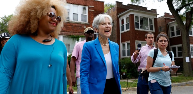 Green Party presidential candidate Jill Stein, center, walks on South Austin neighborhood with community activist Zerlina Smith, left, Thursday, Sept. 8, 2016, in Chicago.