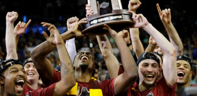 Loyola-Chicago players celebrate a regional final NCAA college basketball tournament game against Kansas State, Saturday, March 24, 2018, in Atlanta. Loyola-Chicago won 78-62.