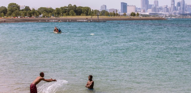 Two children play in the shallow water of Lake Michigan at Chicago's Oakwood Beach, Thursday, June 27, 2019. As of Aug. 1, 2019, there have been 27 drownings in Lake Michigan, many of them in Chicago.