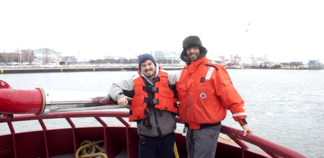 Curious City reporter John Fecile and questioner Devon Neff aboard The Wheatley icebreaking ship.