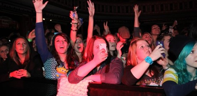 File: Fans at an Ellie Goulding concert use cell phones to capture the event.