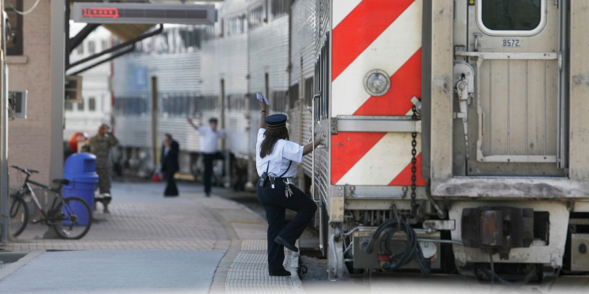 A Metra Train Comes Into A Station