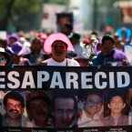 People carry images of people who were disappeared, during a Mother's Day march in Mexico City, Friday, May 10, 2019. Mothers and other relatives of persons gone missing in the fight against drug cartels and organized crime are demanding that authorities locate their loved ones.