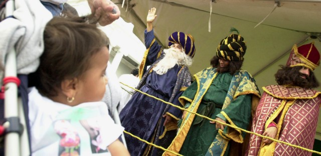 Kadeishla Hernandez, 2 looks at the Three Kings during the Three Kings Day traditional celebration in San Juan, Puerto Rico Thursday, Jan. 6, 2005. For more than twenty years the traditional Puerto Rico Governors Three Kings Day Party bring to low income family a way to obtain presents for their children.