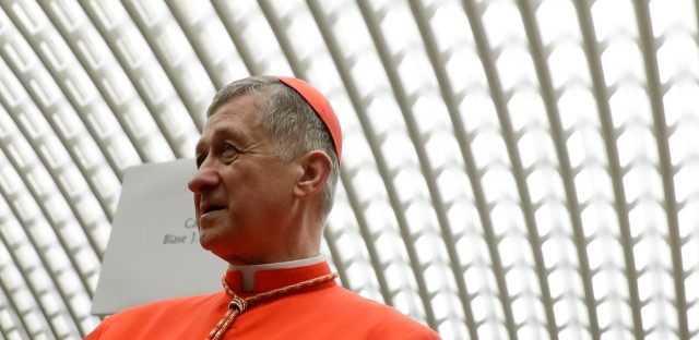 New Cardinal Blase Cupich, Archbishop of Chicago, participates into a meeting of the new cardinals with faithful and relatives in the Paul VI hall at the Vatican, Saturday, Nov. 19, 2016. Pope Francis on Saturday decried what he called a polarizing surge in much of the world to exclude people with different nationalities, races or beliefs as enemies, as he led a ceremony welcoming 17 new cardinals from six continents.