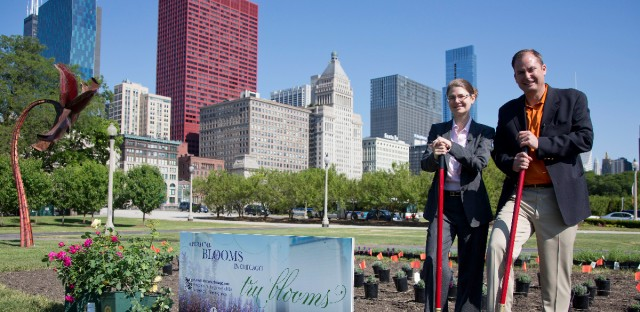 Karen Weigert, left, Chief Sustainability Officer at City of Chicago and Monte Henige, CEO Tru Fragrance pose for a photograph at the Tru Fragrance Tru Blooms Chicago groundbreaking event in Grant Park in Chicago