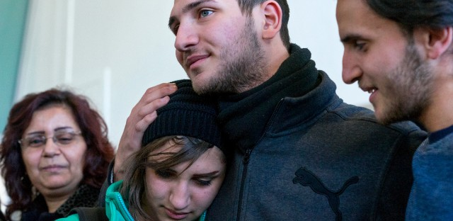 Tawfik Assali, 21, center, of Allentown, Pa., embraces his sister Sarah Assali, 19, upon her and other family members' arrival from Syria at John F. Kennedy International Airport in New York on Feb. 6, 2017. Right is Mathew Assali, 17. Attorneys said Dr. Assali's brothers, their wives and their two teenage children returned to Syria after they were denied entrance to the United States on Jan. 28 although they had visas in hand after a 13-year effort. (AP Photo/Craig Ruttle)