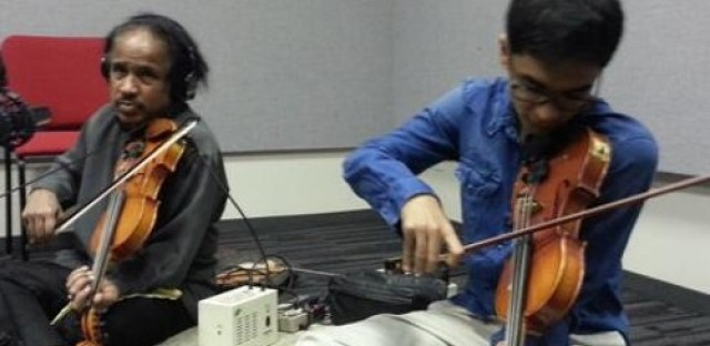 Global Notes: Violin duo perform classical Southern Indian Carnatic music