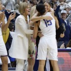 Connecticut head coach Geno Auriemma, right, reacts as Connecticut's Gabby Williams (15) is congratulated by associated head coach Chris Dailey and embraced by assistant coach Marisa Moseley at the end of an NCAA college basketball game against South Carolina, Monday night in Storrs, Conn. UConn won their 100th straight game, 66-55.