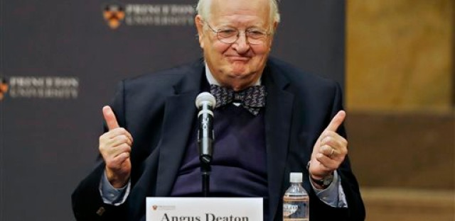 Angus Deaton gestures at a gathering at Princeton University after it was announced that he won the Nobel prize in economics for improving understanding of poverty and how people in poor countries respond to changes in economic policy Monday, Oct. 12, 2015, in Princeton, N.J. Deaton, 69, won the 8 million Swedish kronor
